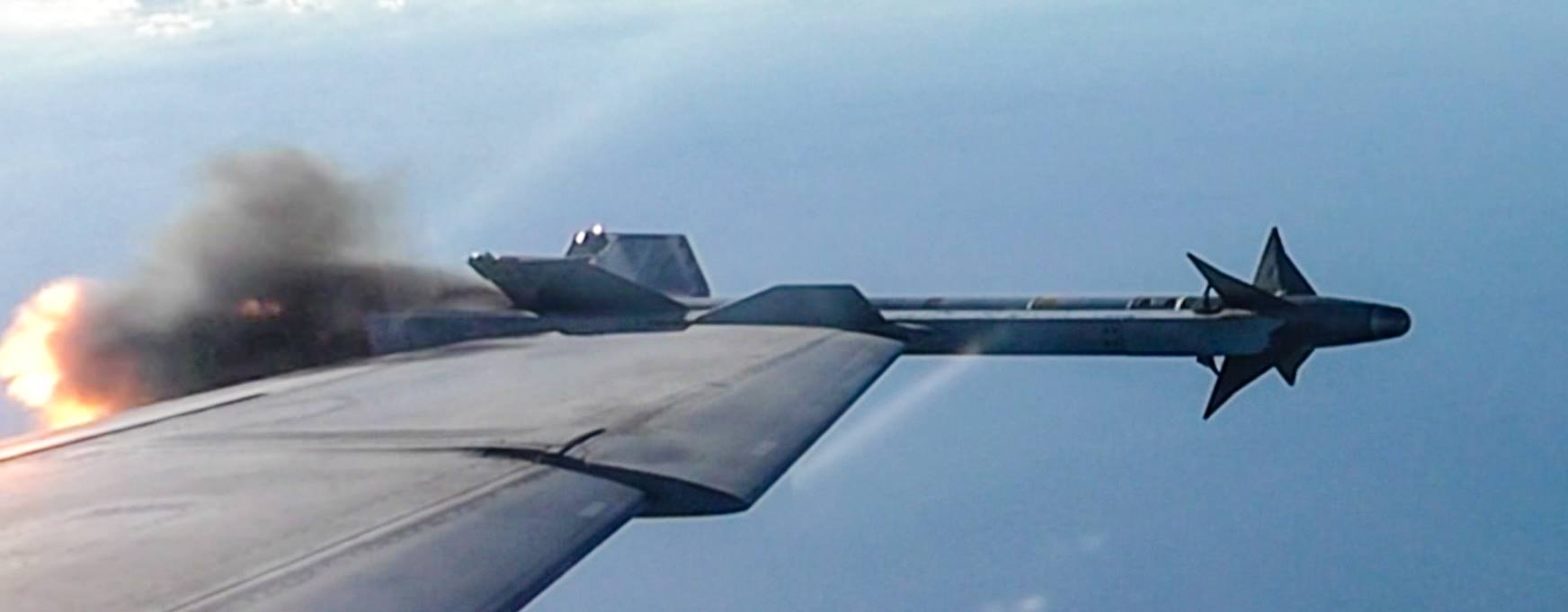 An air-to-air Sidewinder missile launch, just as it starts leaving the wing