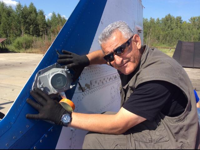Artur Sarkisyan attaching a camera to the MiG-29UB fin